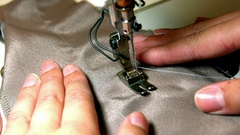 Seamstress stitching cloth on sewing machine Stock Footage