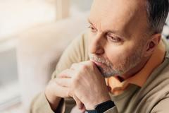 Male pensioner thinking seriously about something Stock Photos