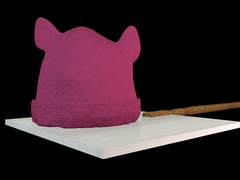 Pink knitted pussy hat upon a placard - black background. Stock Footage