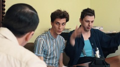 Man in hair net angry arguing with two visitors at office meeting Stock Footage