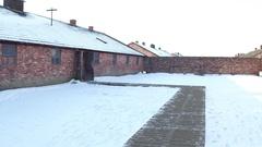 POV walk to Auschwitz Birkenau barrack in winter. Former German Nazi Arkistovideo