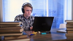Serious student e-learning online with laptop Stock Footage