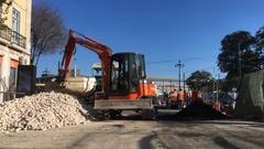 Skid loader Moving Portuguese Rocks Lisbon Stock Footage