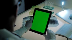 Doctor or researcher is using tablet PC with green screen in modern laboratory Stock Footage