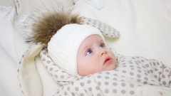 Baby girl in a white jumpsuit Stock Footage