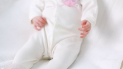 Baby girl white knitted jacket with pink rabbit Stock Footage