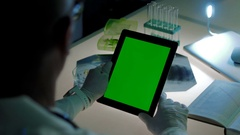 Doctor holds tablet PC in his hands. He works with special medical software and Stock Footage