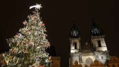 Decorated Christmas tree and Our Lady cathedral, Prague, Czech Republic Stock Footage