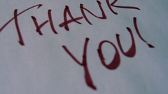 Thank You Text On Paper Background Stock Footage