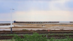 Train with freight wagons trailed carries cargo. The locomotive carries salt Stock Footage