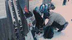 Man helps a girl to put ski boots Stock Footage