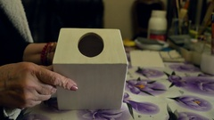 Woman wipes the dust after polishing with the box. Decoupage Stock Footage