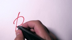 Hand Writing Please Using A Red Marker On A White Paper Stock Footage