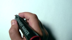 Hand Writing Sorry Using A Red Marker On A White Paper Stock Footage