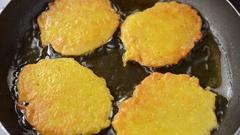 We pan fry hash browns. Stock Footage