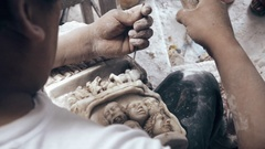 Sculptor carving on marble Stock Footage
