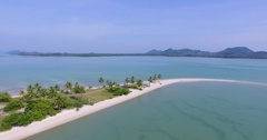 Aerial: Launching the drone on the island spit with white sand and palms. Stock Footage