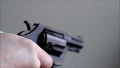 Hand holding older revolver then cocking the hammer back Stock Footage