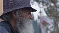 Homeless old man looking in the camera: poor man, beggar man, asking for charity Stock Footage