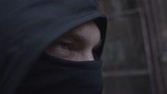 Aggressive masked man on street. Shot on RED cinema camera Stock Footage