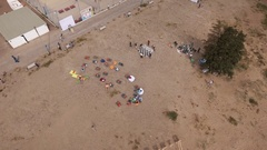 Arial shot sandy beach with recliners, beanbags and giant chess on sunny day Stock Footage