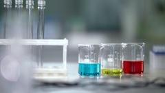 Lab worker put test tubes rack on laboratory table. Laboratory glassware Stock Footage