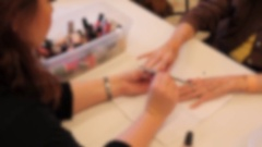 Old woman receives a manicure in a retirement home out of focus Stock Footage