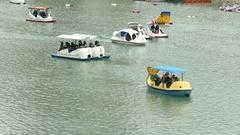 People enjoying Pedalboats on lake in Bitan, New Taipei City Stock Footage