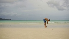 Man doing morning exercises at the beach Stock Footage