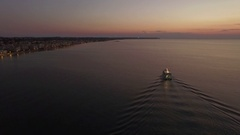 Aerial flight above the sea and coast line on the horizon in Greece Stock Footage