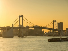 Day to night timelapse footage of the sun setting behind Rainbow Bridge, Tokyo, Stock Footage