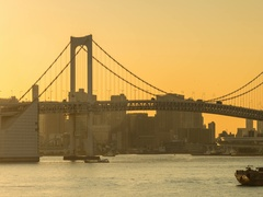 Day to night panning timelapse footage of the sun setting behind Rainbow Bridge, Stock Footage