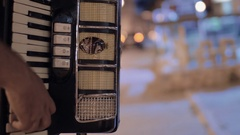 Man playing accordion in the street and earning money Stock Footage