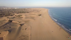 Sandy landscape and blue ocean of Gran Canaria Stock Footage