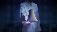 Female researcher, Engineer open palm, cooling tower of nuclear power plant Stock Footage