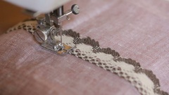 Sewing on the sewing machine, closeup. woman's hand seamstress Stock Footage