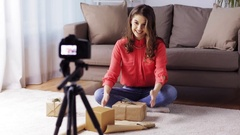 Woman with camera recording video at home Stock Footage