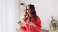 Woman with hairbrush singing and dancing at home Stock Footage
