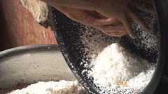 Woman extraction of coconut pulp Stock Footage
