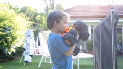 Authentic candid shot of little boy outside holding a truck toy. Stock Footage