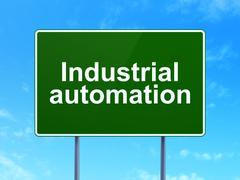 Industry concept: Industrial Automation on road sign background Piirros