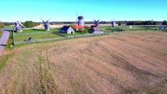 Beautiful old traditional Estonian windmills on field on sunny summer day Stock Footage