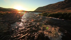Sunset over mountain river in summer Stock Footage