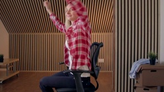 Office chair race. Slow motion. Young woman have fun in the office during a Stock Footage