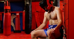 Depressed boxer sitting with hand on face Stock Footage