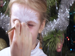 On girl painted on face Stock Footage