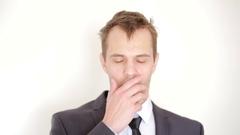Sleepy disheveled man looking into the camera, yawn Stock Footage