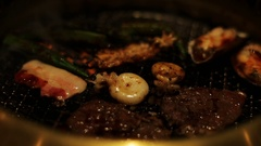 Korean style barbecue with meat and seafood Stock Footage