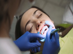 Dentists produce teeth cleaning girl, using tools. Stock Footage