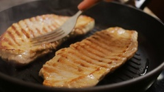 Fry steak meat. closeup. pork in a frying pan Stock Footage